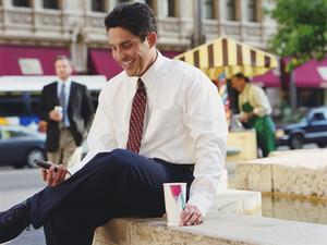 graphicstock-hispanic-businessman-looking-at-cell-phone_SAMYJjWo-b_thumb